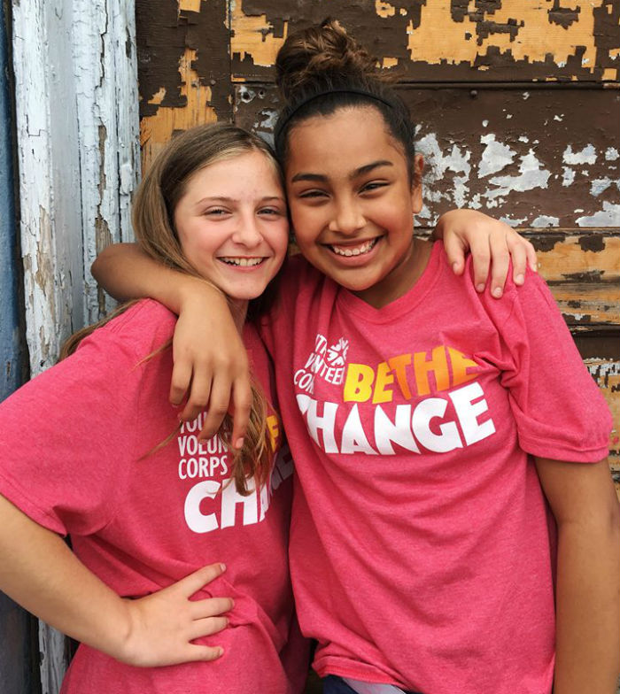 Two youth who became friends while volunteering