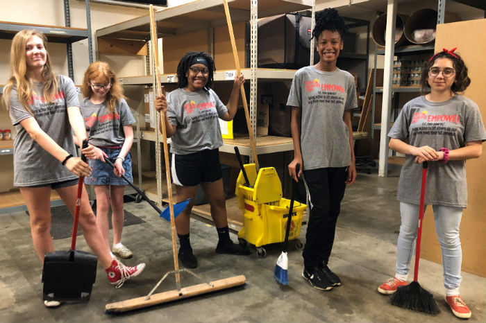 Youth cleaning at a volunteer project
